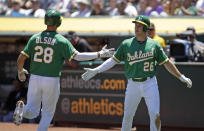 Oakland Athletics' Matt Olson, left, and Matt Chapman (26) celebrate after scoring against the Chicago White Sox in the first inning of a baseball game Saturday, July 13, 2019, in Oakland, Calif. (AP Photo/Ben Margot)