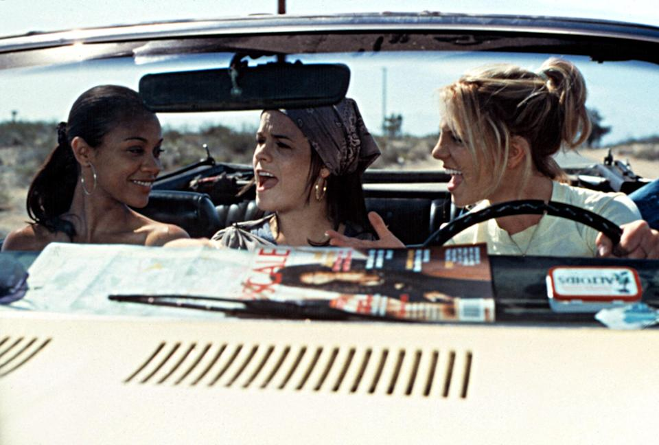 """<p>An epic road trip is an important entry on any travel bucket list, and <em>Crossroads</em> captures the experience perfectly. Fun fact: Shonda Rhimes wrote this movie, which stars Britney Spears, Zoe Saldana, and Taryn Manning, long before <em>Grey's Anatomy</em> and <em>Scandal</em> were in your must-watch queue. </p> <p><em>Available to rent on</em> <a href=""""https://www.amazon.com/Crossroads-Britney-Spears/dp/B0015L7BMI"""" rel=""""nofollow noopener"""" target=""""_blank"""" data-ylk=""""slk:Amazon Prime Video"""" class=""""link rapid-noclick-resp""""><em>Amazon Prime Video</em></a><em>.</em></p>"""