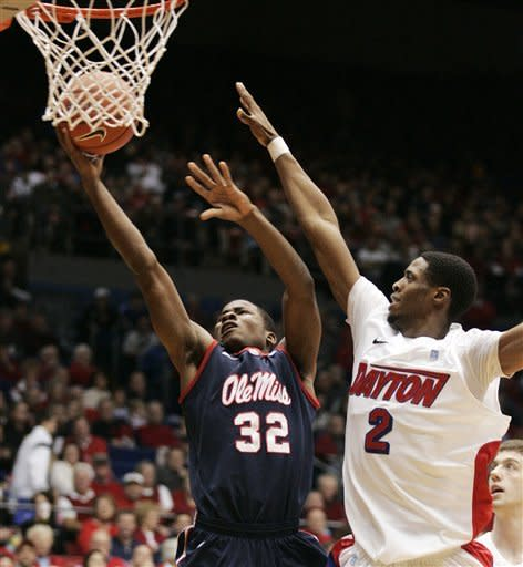 Mississippi's Jarvis Summers (32) goes to the basket while Dayton's Josh Benson (2) defends during the first half of an NCAA college basketball game, Friday, Dec. 30, 2011, in Dayton, Ohio. (AP Photo/Skip Peterson)