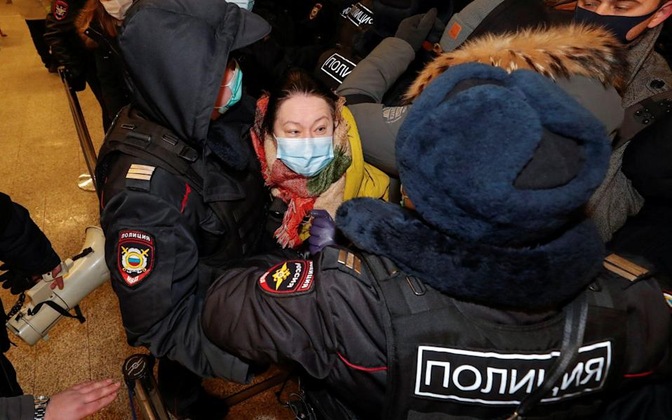 Police arrested people waiting to meet the opposition leader in Moscow - Handout via REUTERS