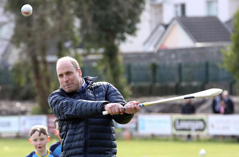 Britain's Prince William, Duke of Cambridge (L) reacts as he attempts to play hurling during a visit to Salthill Gaelic Athletic Association (GAA) club in Galway, western Ireland, on March 5, 2020 on the final day of their three day visit. (Photo by Paul Faith / AFP) (Photo by PAUL FAITH/AFP via Getty Images)