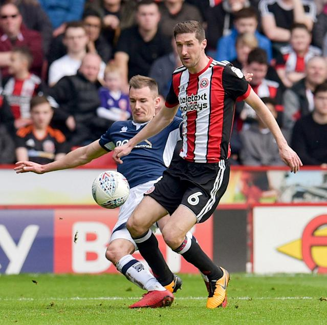 "Soccer Football - Championship - Sheffield United vs Millwall - Bramall Lane, Sheffield, Britain - April 14, 2018 Sheffield United's Chris Basham in action with Millwall's Jed Wallace Action Images/Paul Burrows EDITORIAL USE ONLY. No use with unauthorized audio, video, data, fixture lists, club/league logos or ""live"" services. Online in-match use limited to 75 images, no video emulation. No use in betting, games or single club/league/player publications. Please contact your account representative for further details."
