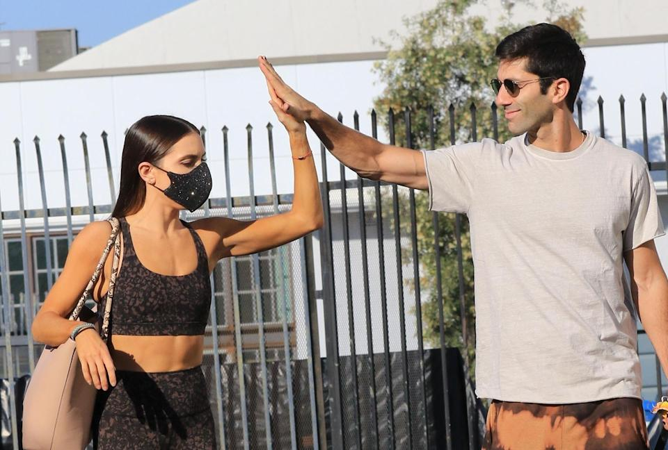 <p><em>Dancing with the Stars </em>partners Nev Schulman and Jenna Johnson arrive for practice in L.A. on Tuesday. </p>