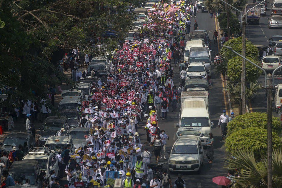 Anti-coup protesters march in Yangon, Myanmar, Thursday, Feb. 25, 2021. Social media giant Facebook announced Thursday it was banning all accounts linked to Myanmar's military as well as ads from military-controlled companies in the wake of the army's seizure of power on Feb. 1. (AP Photo)