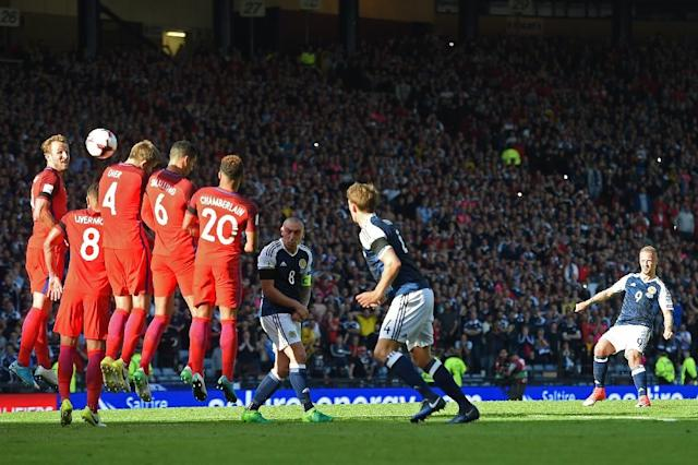 Scotland's striker Leigh Griffiths (R) hits a freekick over the England wall to score their second goal during the group F World Cup qualifying football match between Scotland and England at Hampden Park in Glasgow - the game ended 2-2 (AFP Photo/Paul ELLIS)