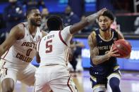 Boston College's Frederick Scott (0) and Jay Heath (5) defend against Notre Dame's Prentiss Hubb (3) during the first half of an NCAA college basketball game, Saturday, Feb. 27, 2021, in Boston. (AP Photo/Michael Dwyer)