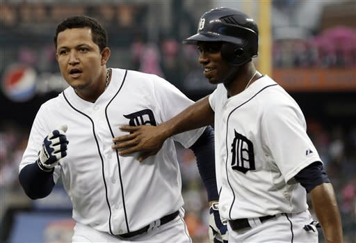 Detroit Tigers' Miguel Cabrera, left, celebrates hitting a two-run home run with Austin Jackson against Cleveland Indians starting pitcher Ubaldo Jimenezin the first inning of a baseball game in Detroit, Wednesday, Sept. 5, 2012. (AP Photo/Paul Sancya)