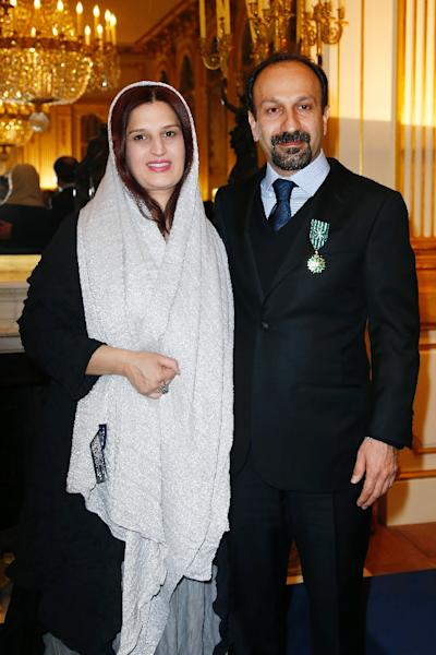 Iranian director Asghar Farhadi poses with his wife Parisa after being awarded an 'Officier des Arts et Lettres' medal by the French minister of culture, in Paris (AFP Photo/Thomas Samson)
