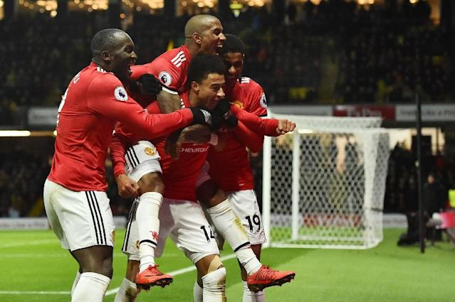 Manchester United midfielder Jesse Lingard (C) celebrates with teammates after scoring their fourth goal against Watford at Vicarage Road Stadium in Watford, north of London on November 28, 2017 (AFP Photo/Glyn KIRK )
