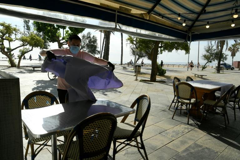 Some cafes were also allowed to reopen -- but for outdoor dining only (AFP Photo/LLUIS GENE)