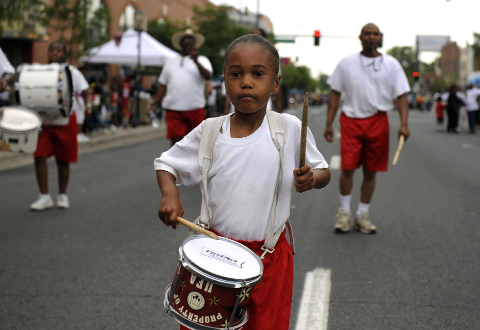 Gabriel Buckmon, 5, plays with the Syrian Temple 49 Youth Drum & Flag Corps during the Juneteenth Parade, in the historic Five Points neighborhood, in Denver, CO. (Craig F. Walker / The Denver Post via Getty Images)