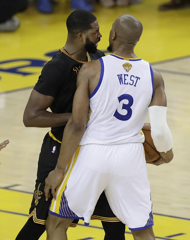 <p>Cleveland Cavaliers center Tristan Thompson, left, confronts Golden State Warriors forward David West (3) during the first half of Game 5 of basketball's NBA Finals in Oakland, Calif., Monday, June 12, 2017. (AP Photo/Marcio Jose Sanchez) </p>