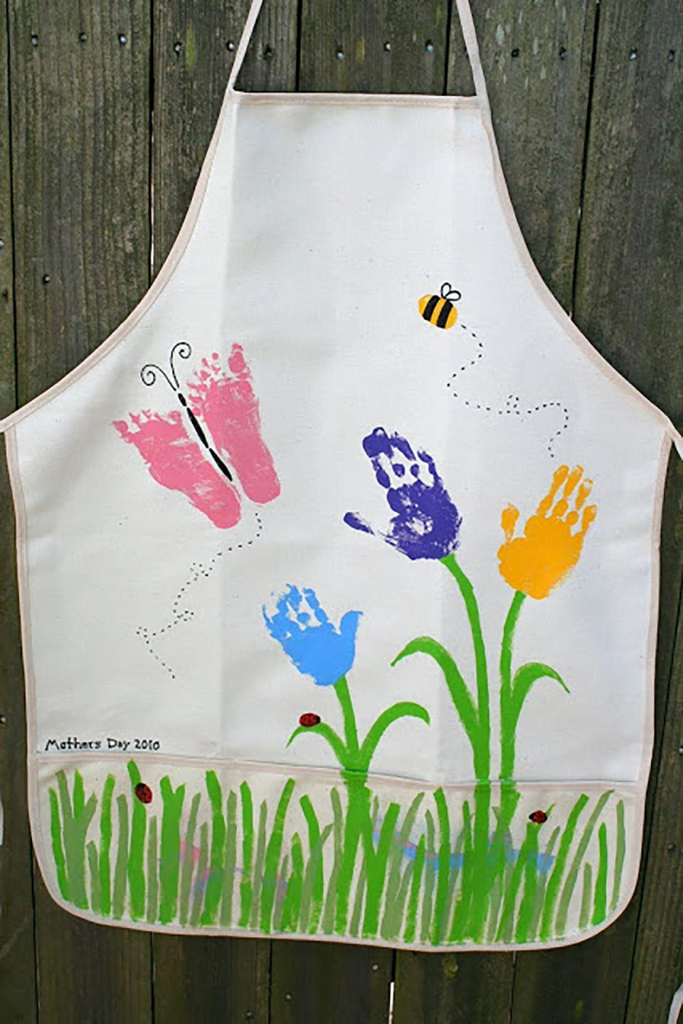 """<p>Mom will love wearing this precious apron when she heads out into her garden this spring.</p><p><strong>Get the tutorial at <a href=""""http://littlepageturners.blogspot.com/2010/05/mothers-day-handprint-and-such-apron.html"""" rel=""""nofollow noopener"""" target=""""_blank"""" data-ylk=""""slk:Little Page Turners"""" class=""""link rapid-noclick-resp"""">Little Page Turners</a>. </strong></p><p><strong>What you'll need: </strong><em>apron ($10 for 3-pack, </em><em><a href=""""https://www.walmart.com/ip/Next-Style-Canvas-Aprons-3-Pack-White/20711685"""" rel=""""nofollow noopener"""" target=""""_blank"""" data-ylk=""""slk:walmart.com"""" class=""""link rapid-noclick-resp"""">walmart.com</a>)</em></p>"""