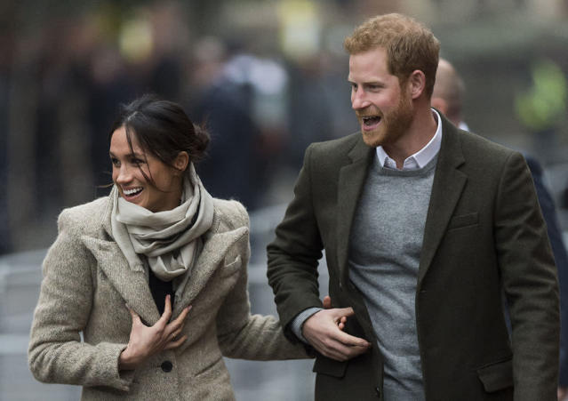 <p>The princess-to-be seemed surprised and delighted by the swarm of fans that gathered to get a glimpse of the royal couple in London on Tuesday. The newly engaged pair were headed to visit Reprezent 107.3FM in Brixton, which trains hundreds of young people every year in media and employment skills. (Photo: Mark Cuthbert/UK Press via Getty Images) </p>