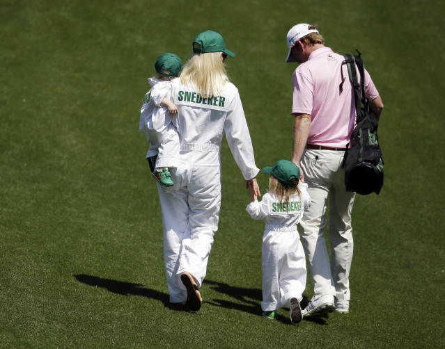 Brandt Snedeker walks with his wife Mandy and children Austin and Lily, second right, for the par three competition at the Masters golf tournament Wednesday, April 9, 2014, in Augusta, Ga. (AP Photo/Darron Cummings)