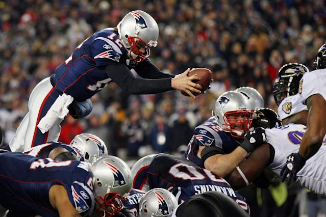 FOXBORO, MA - JANUARY 22: Tom Brady #12 of the New England Patriots dives into the end zone to score a touchdown in the fourth quarter against the Baltimore Ravens during their AFC Championship Game at Gillette Stadium on January 22, 2012 in Foxboro, Massachusetts. (Photo by Elsa/Getty Images)