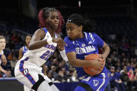 Seton Hall guard Mya Jackson, right, drives against DePaul forward Chante Stonewall during the second half of an NCAA college basketball game in the Big East women's tournament semifinals, Sunday, March 8, 2020, in Chicago. (AP Photo/Nam Y. Huh)