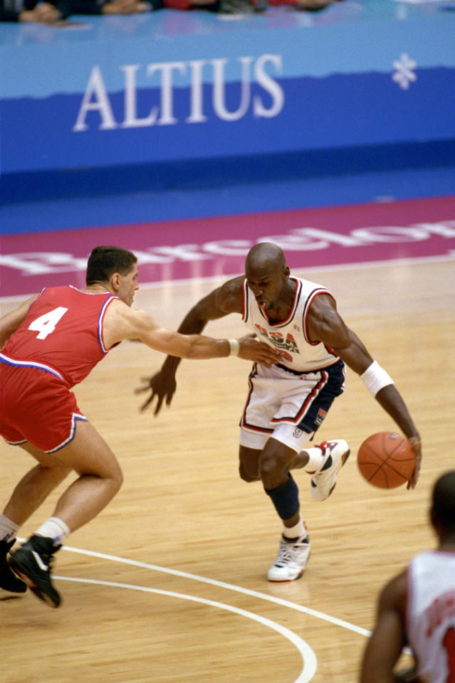 "BARCELONA, SPAIN - AUGUST 8: Michael Jordan #9 of the United States is covered by Drazen Petrovic #4 of Croatia in the 1992 Olympic game on August 8, 1992 in Barcelona, Spain. The ""Dream Team"" defeated Croatia 117-85. NOTE TO USER: User expressly acknowledges and agress that, by downloading and or using this photograph, User is consenting to the terms and conditions of the Getty Images License Agreement. (Photo by Shaun Botterill/Getty Images)"