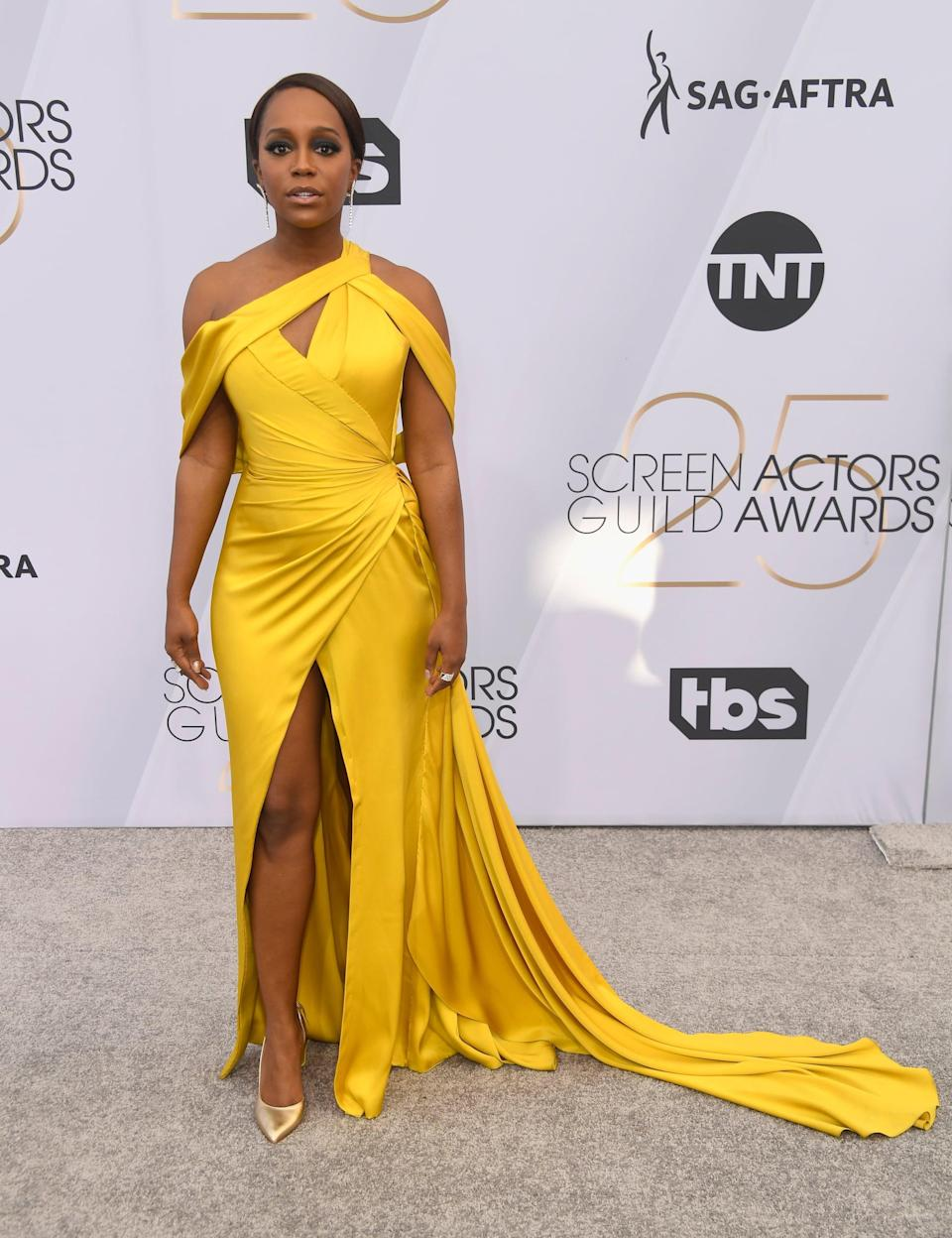 <p>Wearing a strappy yellow Ralph and Russo dress with Chloe Gosselin shoes and Effy jewelry.</p>