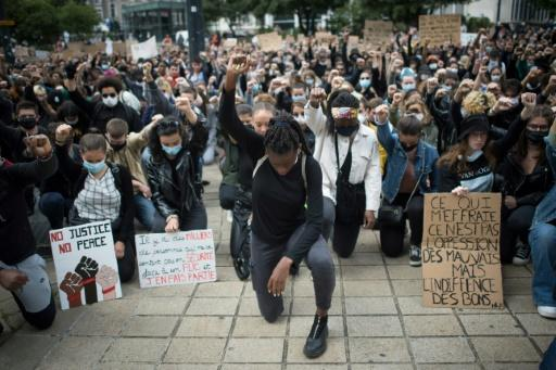 Demonstrators dropped to their knees and raised a fist as they turned out to march in the western city of Nantes