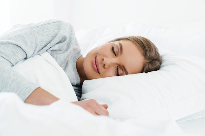 woman smiling while sleeping