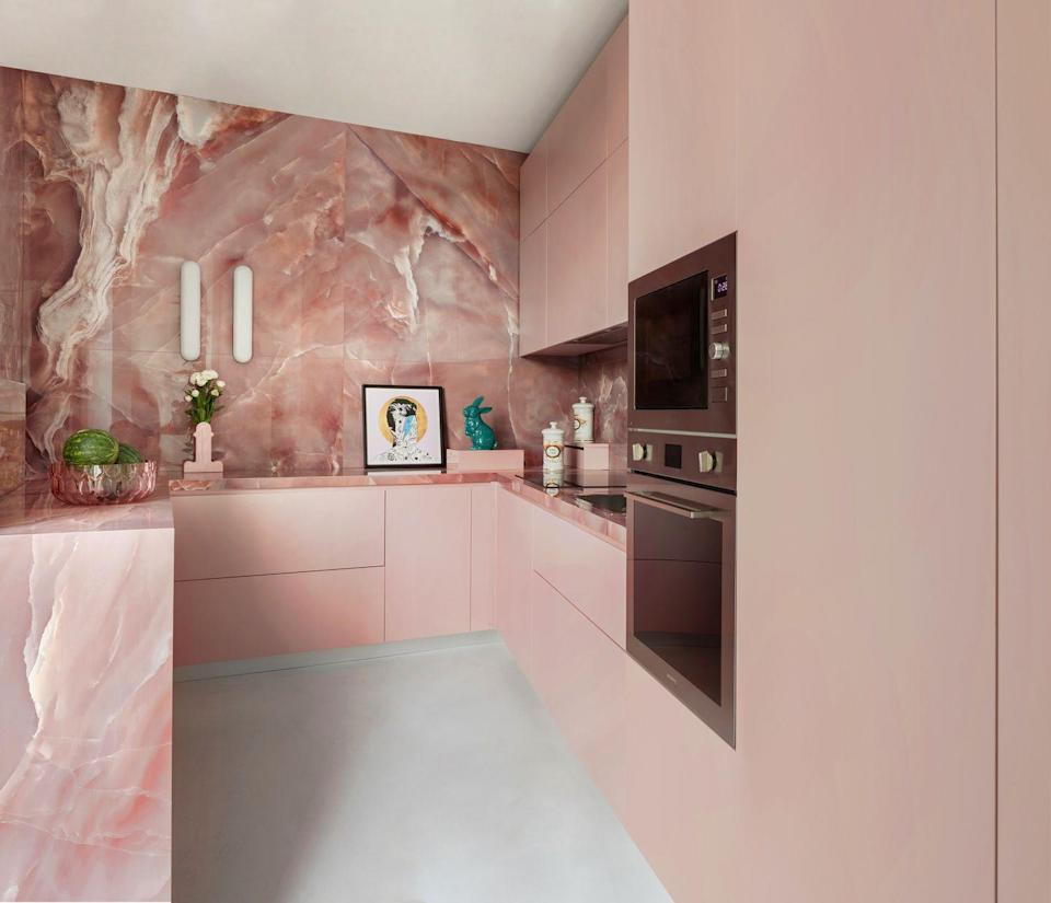 """<p>If you've chosen a colour for your kitchen, why not go all in and apply it to worktops, walls and cupboards for maximum effect? In this bubblegum pink kitchen belonging to the owners of rug brand <a href=""""https://elledecoration.co.uk/houses/a35029955/cc-tapis-home-milan/"""" rel=""""nofollow noopener"""" target=""""_blank"""" data-ylk=""""slk:CC-Tapis"""" class=""""link rapid-noclick-resp"""">CC-Tapis</a>, pink onyx adds a luxe, grown-up twist and depth. For natural stone in an array of colours, try Antolini. <a href=""""https://www.antolini.com/en/"""" rel=""""nofollow noopener"""" target=""""_blank"""" data-ylk=""""slk:antolini.com"""" class=""""link rapid-noclick-resp"""">antolini.com</a></p>"""
