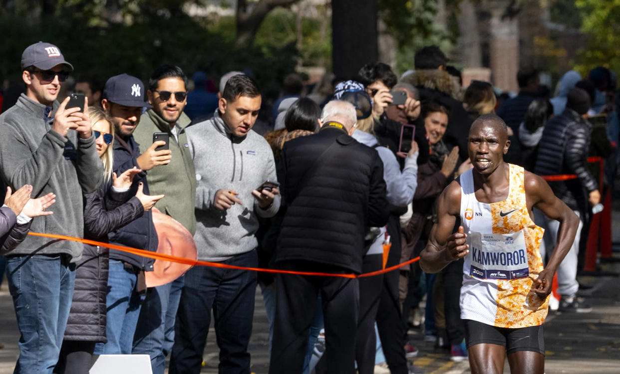 Geoffrey Kamworor of Kenya runs alone as he leads in the last minutes of the New York City Marathon. Kamworor went on to win. (Photo: Craig Ruttle/AP)