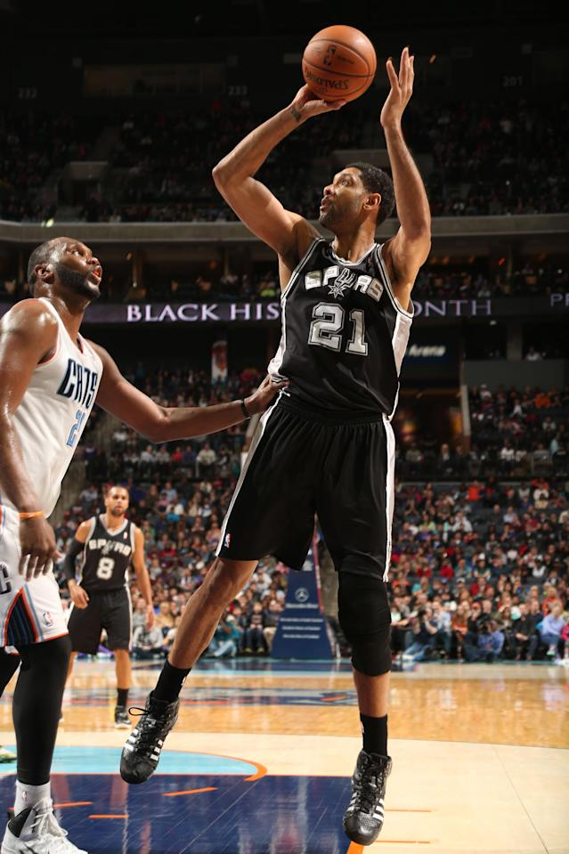 CHARLOTTE, NC - FEBRUARY 8: Tim Duncan #21 of the San Antonio Spurs shoots against the Charlotte Bobcats during the game at the Time Warner Cable Arena on February 8, 2014 in Charlotte, North Carolina. (Photo by Brock Williams-Smith/NBAE via Getty Images)