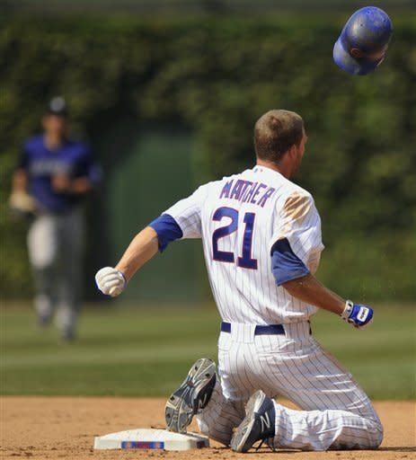 Chicago Cubs' Joe Mather throws his helmet after being caught stealing second base by the Colorado Rockies in the seventh inning of a baseball game in Chicago, Saturday, Aug. 25, 2012. Colorado won 4-3. (AP Photo/Paul Beaty)
