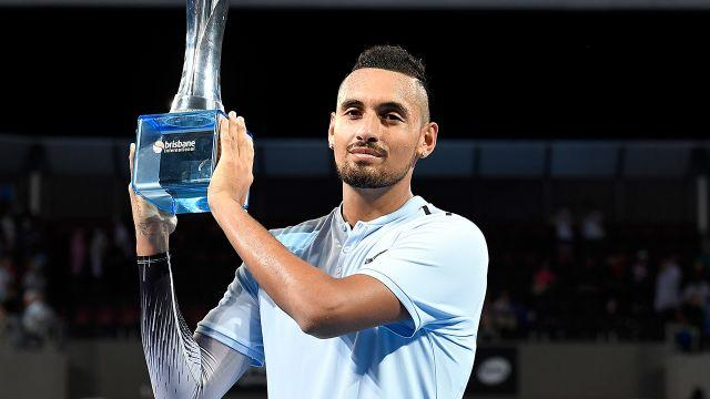 Kyrgios and his prize. Image: Getty