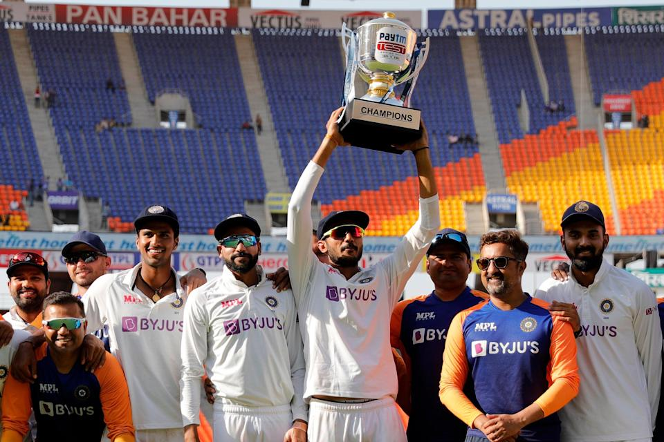 Axar Patel of India raising high the series trophy (BCCI)