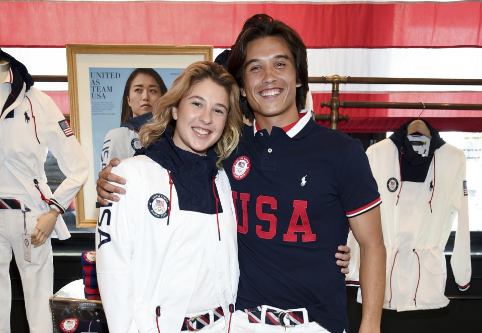 Skateboaders Jordyn Barratt, left, and Heimana Reynolds participate in the Team USA Tokyo Olympic closing ceremony uniform unveiling at the Ralph Lauren SoHo Store on April 13, 2021, in New York. Ralph Lauren is an official outfitter of the 2021 U.S. Olympic Team. (Photo by Evan Agostini/Invision/AP)
