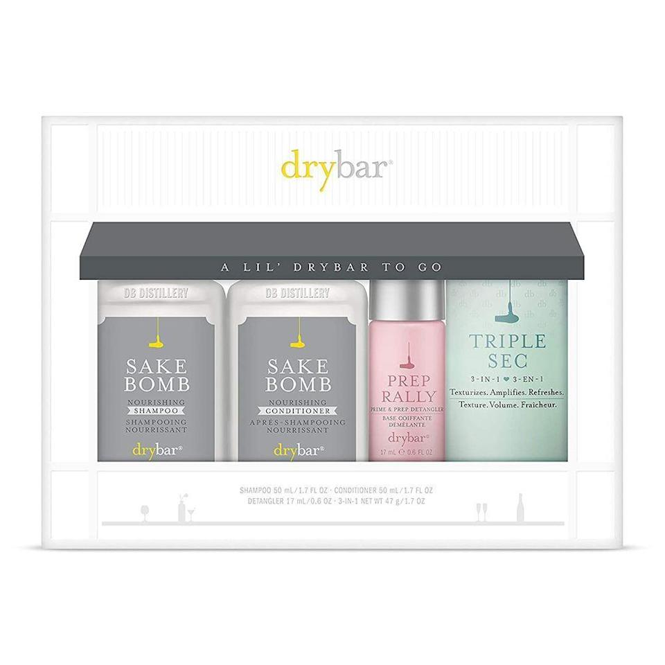 """<p><strong>Drybar</strong></p><p>amazon.com</p><p><strong>$29.00</strong></p><p><a href=""""https://www.amazon.com/dp/B088T4QCWC?tag=syn-yahoo-20&ascsubtag=%5Bartid%7C2141.g.30609393%5Bsrc%7Cyahoo-us"""" rel=""""nofollow noopener"""" target=""""_blank"""" data-ylk=""""slk:Shop Now"""" class=""""link rapid-noclick-resp"""">Shop Now</a></p><p>You know she has a Drybar obsession, and let me tell you: It's not just the blowout she loves, it's the products too. Treat her to the best ones at home (shampoo, conditioner, detangler, finishing spray) and you might just get lucky tonight. </p>"""