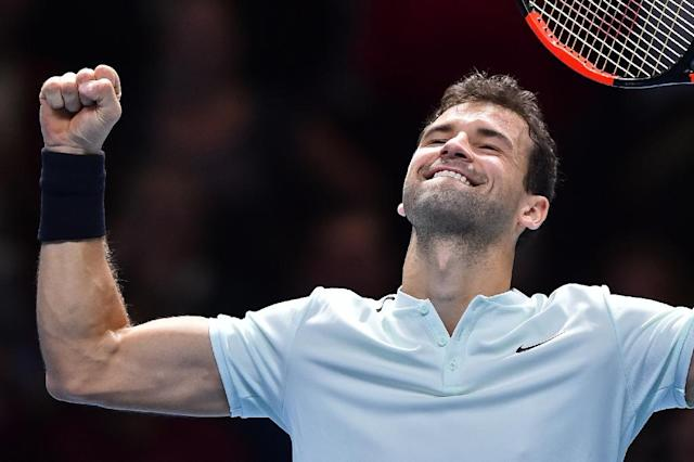Bulgaria's Grigor Dimitrov celebrates his three set victory over Austria's Dominic Thiem during day two of the ATP World Tour Finals tennis tournament at the O2 Arena in London on November 13, 2017 (AFP Photo/Glyn KIRK )