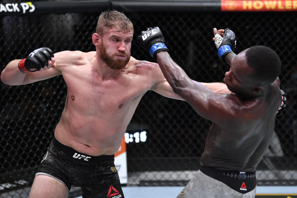 LAS VEGAS, NEVADA - MARCH 06: (L-R) Jan Blachowicz of Poland punches Israel Adesanya of Nigeria in their UFC light heavyweight championship fight during the UFC 259 event at UFC APEX on March 06, 2021 in Las Vegas, Nevada. (Photo by Jeff Bottari/Zuffa LLC)