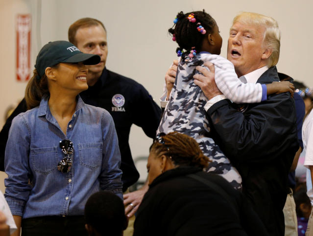 <p>President Donald Trump lifts up a little girl as he and first lady Melania Trump visit with flood survivors of Hurricane Harvey at a relief center in Houston, Texas, Sept. 2, 2017. (Photo: Kevin Lamarque/Reuters) </p>