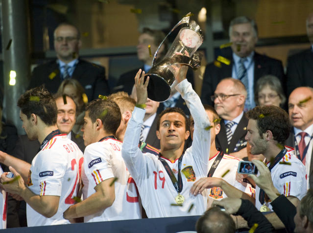 Spain's second goal scorer Thiago Alcantara, celebrates with the trophy at the end of the UEFA Under-21 European Championship final football match Spain vs Switzerland at the Aarhus Stadium, on June 25, 2011. Spain win the final with 2-0.AFP PHOTO/JONATHAN NACKSTRAND (Photo credit should read JONATHAN NACKSTRAND/AFP/Getty Images)