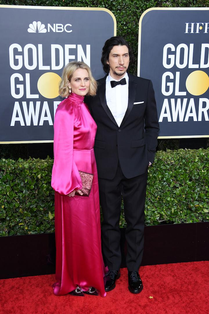 Joanne Tucker is wearing a fuschia-hued satin dress while Adam Driver opted for a tuxedo. <em>[Photo: Getty]</em>