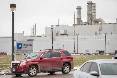 FILE PHOTO: A worker driving a GMC Terrain leaves the General Motors CAMI car assembly plant where the GMC Terrain and Chevrolet Equinox are built, in Ingersoll, Ontario, Canada,  January 27, 2017.  REUTERS/Geoff Robins/File Photo