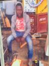 A photograph in a family album shows Yusuf Kimuli who was killed during riots in Kampala