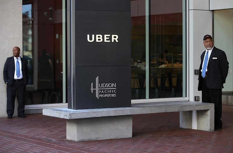 Private security guards stand in front of Uber headquarters on June 13, 2017 in San Francisco, California. (Justin Sullivan/Getty Images)