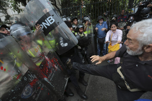 "<p>An anti-government protester kicks at riot police blocking a march of elders against President Nicolas Maduro in Caracas, Venezuela, May 12, 2017. The protest billed as the ""March of the Grandparents"" comes on the heels of six weeks of political unrest that have left some three dozens killed. (Photo: Fernando Llano/AP) </p>"