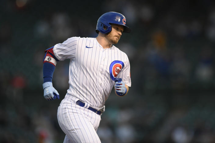 Chicago Cubs' Ian Happ rounds third base after hitting a solo home run during the first inning of the team's baseball game against the Cincinnati Reds on Wednesday, Sept. 8, 2021, in Chicago. (AP Photo/Paul Beaty)