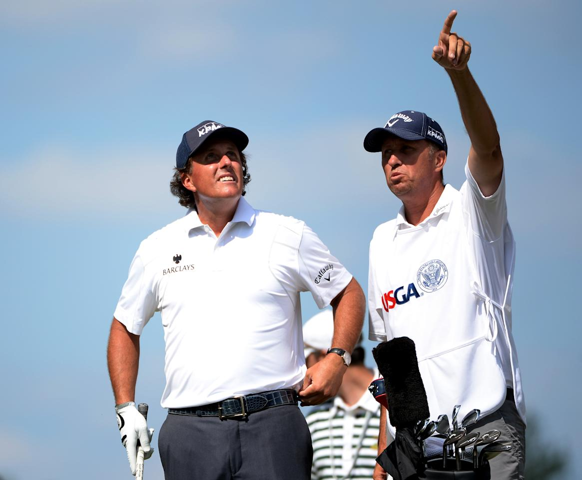 ARDMORE, PA - JUNE 15: Phil Mickelson of the United States talks with caddie Jim Mackay on the fifth tee during Round Three of the 113th U.S. Open at Merion Golf Club on June 15, 2013 in Ardmore, Pennsylvania. (Photo by Ross Kinnaird/Getty Images)