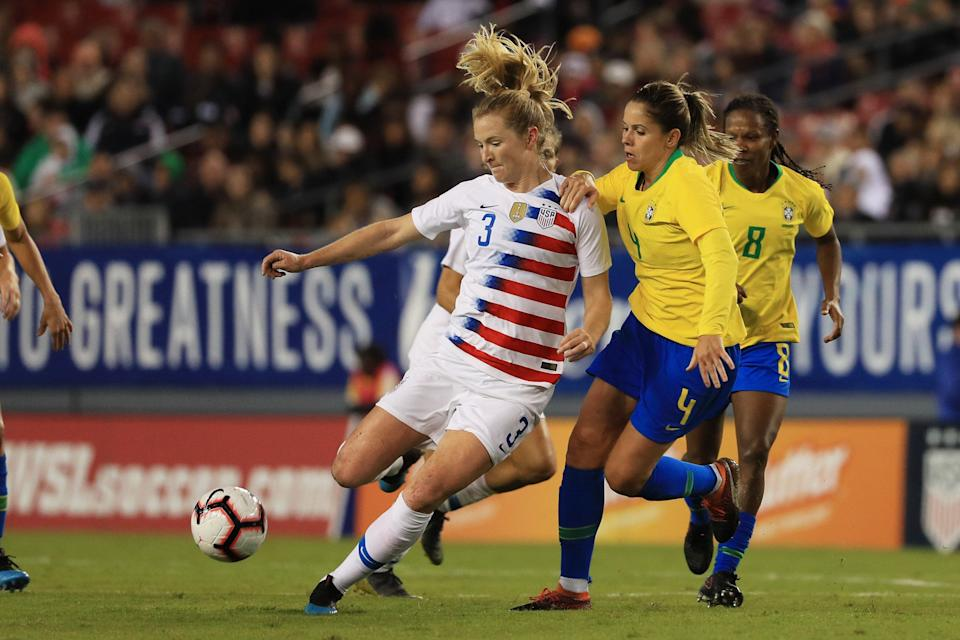 TAMPA, FLORIDA - MARCH 05: Samantha Mewis #3 of the USA looks to pass the ball over Erika #4 of Brazil in the first half during the She Believes Cup  at Raymond James Stadium on March 05, 2019 in Tampa, Florida. (Photo by Mike Ehrmann/Getty Images)