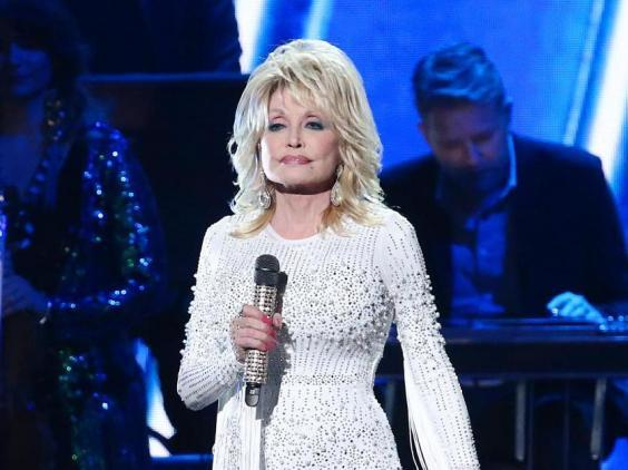 Dolly Parton performs onstage at the 53rd annual CMA Awards in Nashville, Tennessee, 2019 (Getty Images)