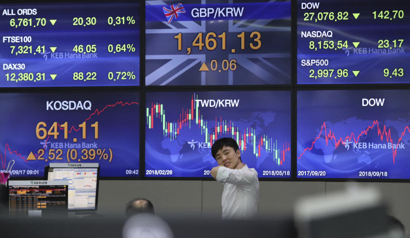 A currency trader works at the foreign exchange dealing room of the KEB Hana Bank headquarters in Seoul, South Korea, Tuesday, Sept. 17, 2019. Shares were mostly lower in Asia on Tuesday after an attack on Saudi Arabia's biggest oil processing plant caused crude prices to soar, prompting selling of airlines and other fuel-dependent industries. (AP Photo/Ahn Young-joon)