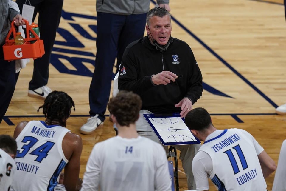 Creighton head coach Greg McDermott talks to his team during the first half of an NCAA college basketball game against the Butler in the Big East conference tournament Thursday, March 11, 2021, in New York. (AP Photo/Frank Franklin II)