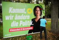 Placards being placed on boards in Bonn for Germany's general election on September 26