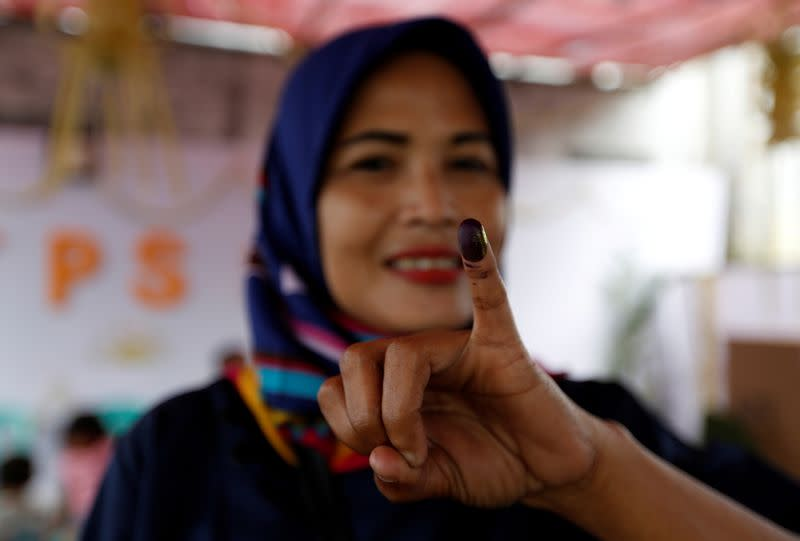 Indonesia president urged to delay regional polls over contagion threat
